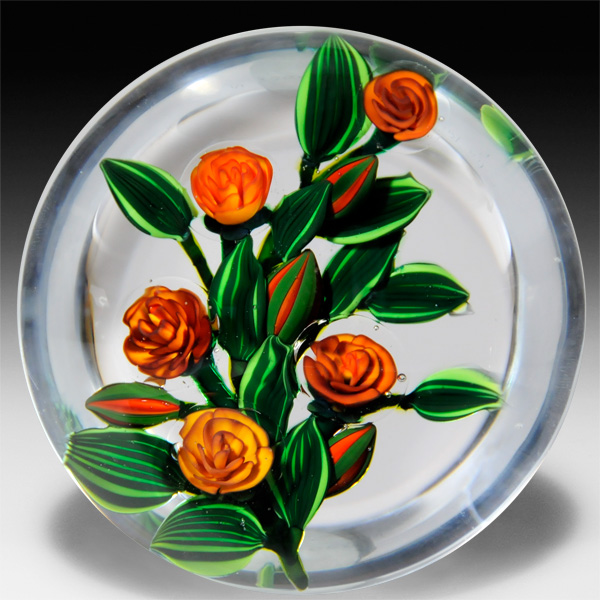 Colin Richardson 2015 golden yellow roses on a branch glass paperweight. by Colin Richardson