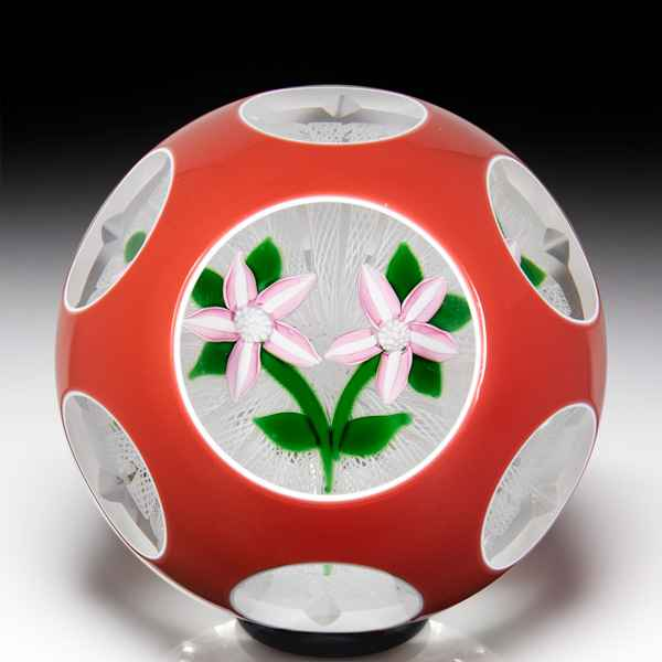 John Deacons pink rose encased faceted double overlay paperweight. by John Deacons