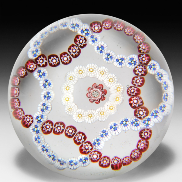 Antique Baccarat interlaced trefoil millefiori garland paperweight. by  Baccarat Antique