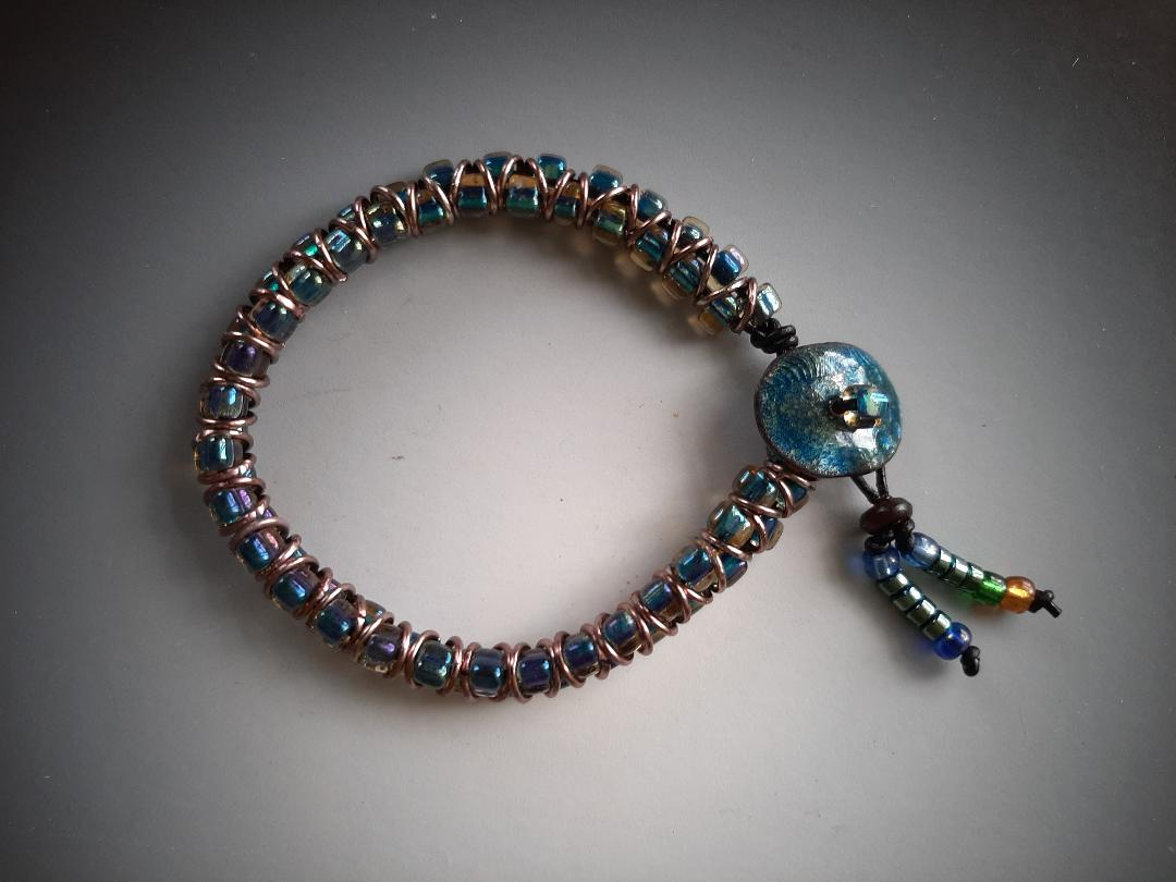 Beaded Bracelet with Enamel Button and Copper Rings