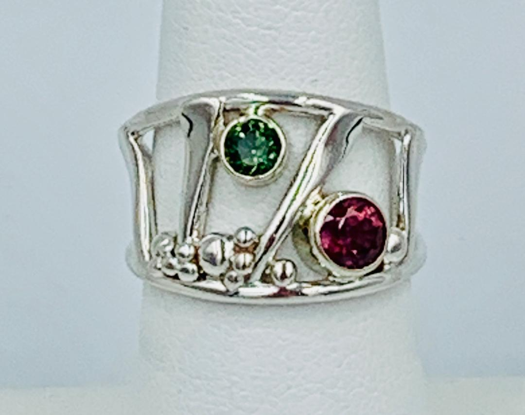 Sapphire and Garnet Ring in Sterling Silver/14 kt white gold with .23 kt Green Sapphire/ Rhodalite Garnet. Size 7.25